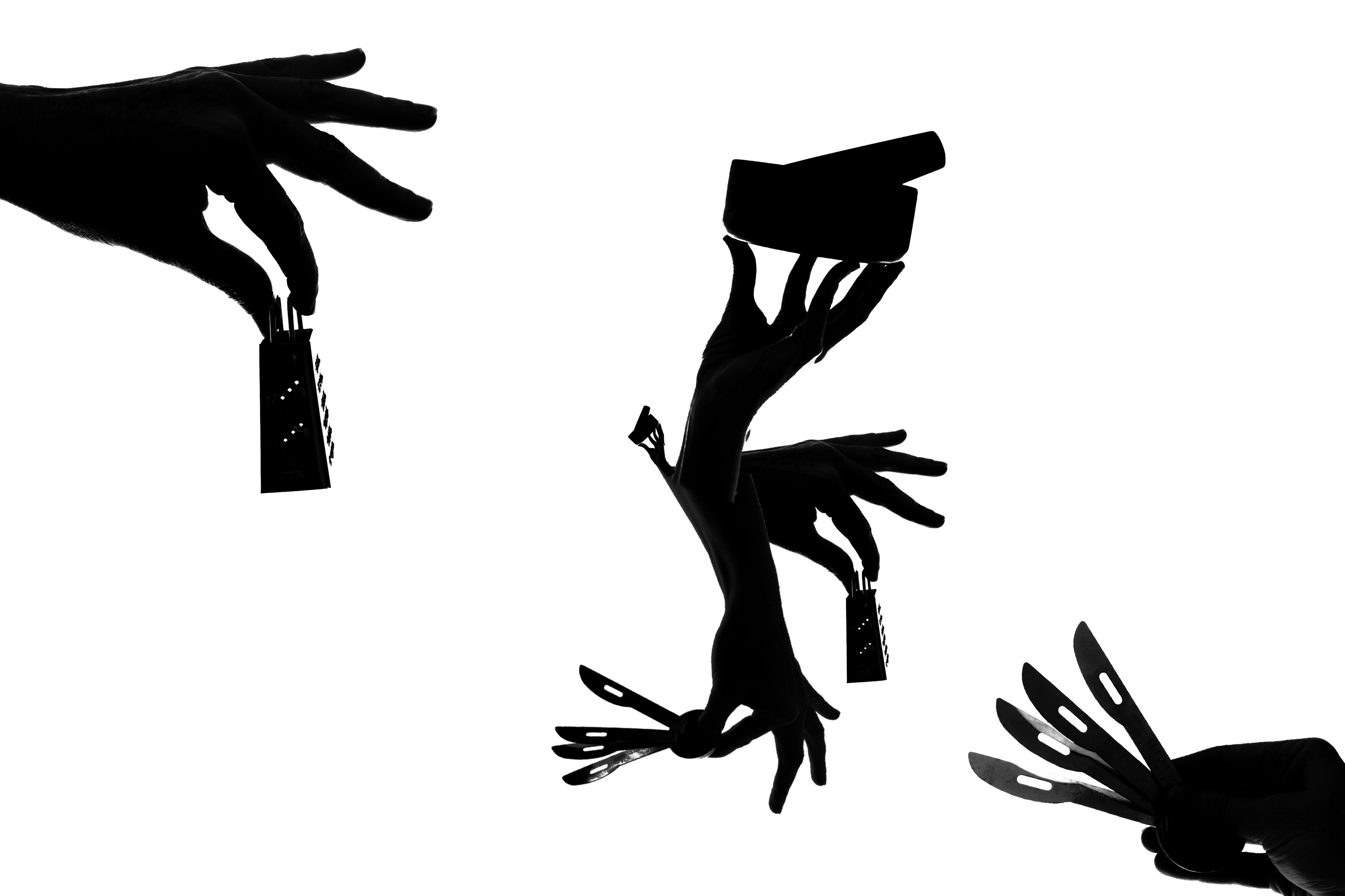 Stencil style silhouettes of feminine hands holding kitchen apothecary tools including a mortar and pestle, tiny knives and measuring sppons, and tiny graters.